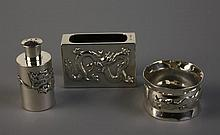A Silver Matchbox Cover, Shaker and Napkin Ring.