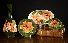 Four Pieces of Moorcroft decorated with coral