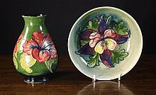 Two Pieces of Moorcroft Pottery: A baluster vase