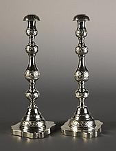 A Pair of Silver Candle Sticks. The knopped stems