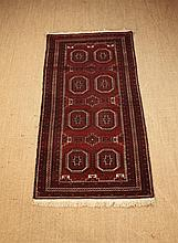 A Finely Woven Wool Rug worked in ivory,