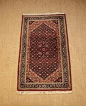 A Fine Thick Wool Weave Rug. The red ground
