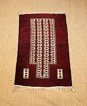 A Prayer Rug woven in silky wools with ivory