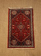 A Red Ground Wool Rug woven with tree-of-life and