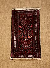 A Silky Wool Carpet woven predominantly in red,