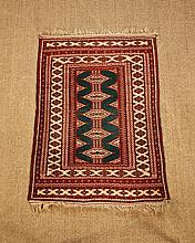 A Silky Wool Rug woven with five elongated