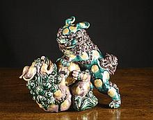 A Oriental Ceramic Animal Group modelled with a
