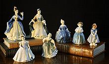 A Collection of Seven Royal Doulton Figurines: