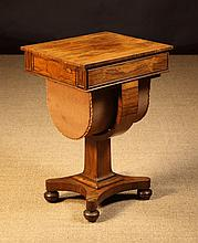 A Regency Rosewood Work Table. The rectangular top