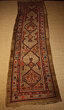 A Sarab Wool Runner. Light brown ground with a