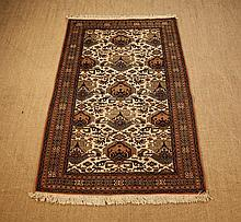 A Cream Ground Carpet woven with geometric