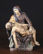 A Small 16th Century German Carved & Polychromed Pieta, 12½ ins (32 cms) high.