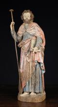 A 17th Century Polychromed Oak Carving of an Apostle, 26 ins (66 cms) high.