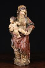 A Delightful Late 17th/Early 18th Century Polychrome & Gilt Wood Carving of Mother & Child, 17 ins (43 cms) in height.