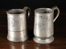 Two Antique Pewter Quart Tankards from the Michael Boorer Collection; one engraved with initials JEG, the other with initials JM in a foliated cartouche above inscription 'ENTIRE BUTT'.