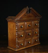 A 19th Century Mahogany Spice Cupboard having a architectural pediment above nine fielded panel drawers centred by brass stud handles. The sides adorned with split bobbin turned spindles, 16 ins (41 cms) high, 13¾ ins (35 cms) wide, 5¾ ins (14.5 cms) in deep.