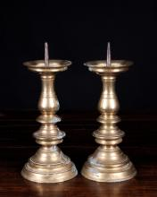 A Pair of 17th Century Bronze Pricket Sticks, 11½ ins (30 cms) in height.