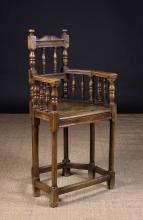 A Late 16th Century/Early 17th Century Franco-Flemish Walnut Cacquetuese Armchair with turned supports.