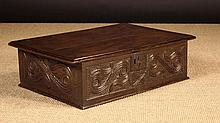A 17th Century Boarded Oak Desk Box carved with