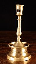 A 16th Century Brass Candlestick. The candle