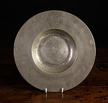 An 18th Century Pewter Charger. The border