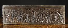 A 17th Oak Panel carved with interlaced lunette