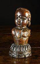 A 17th Century & Later Carved Oak Bust of a girl;