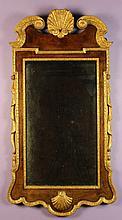 A George I Walnut & Parcel Gilt Wall Mirror.  The