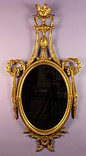 A Neo-Classical Giltwood Girondole.  The oval mirr