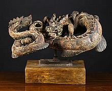 A Carved Wooden Sculpture of a Scrolling Scaly Dra