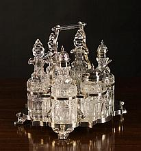 A Fine Six Bottle Cruet Set with Silver Mounts on