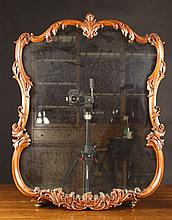 A Delightful Cherrywood Cartouche Shaped Wall Mirr