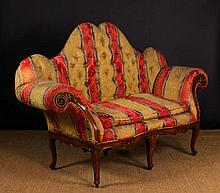 A French Camel Back Settee of exaggerated form. Th