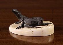 A Small 19th Century Oriental Bronze Lizard on an