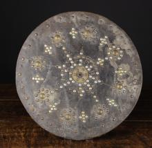 A Scottish Highlander's Leather-clad Wooden Targe or Sheild, with decorative studs and date 1715 marked out in nail heads, 18 ins (46 cms) in diameter.