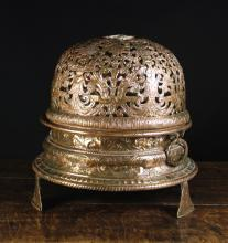 A Fine Late 17th Century Pierced Copper Brazier with elaborate repoussé decoration, 18 ins (46 cms) high, 16½ ins (42 cms) in diameter.