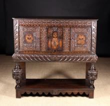 A 17th Century & Later Oak Buffet. The edge moulded top above a rail of arabesque strap-work and two carved panel doors flanking an arcaded centre panel enriched with inlaid flowering plants. The gadrooned frieze housing a long drawer on bulbous cup & cover posts leading down to a pot shelf below. 48 ins (122 cms) high, 47 ins (120 cms) wide, 17 ins (43 cms) deep.