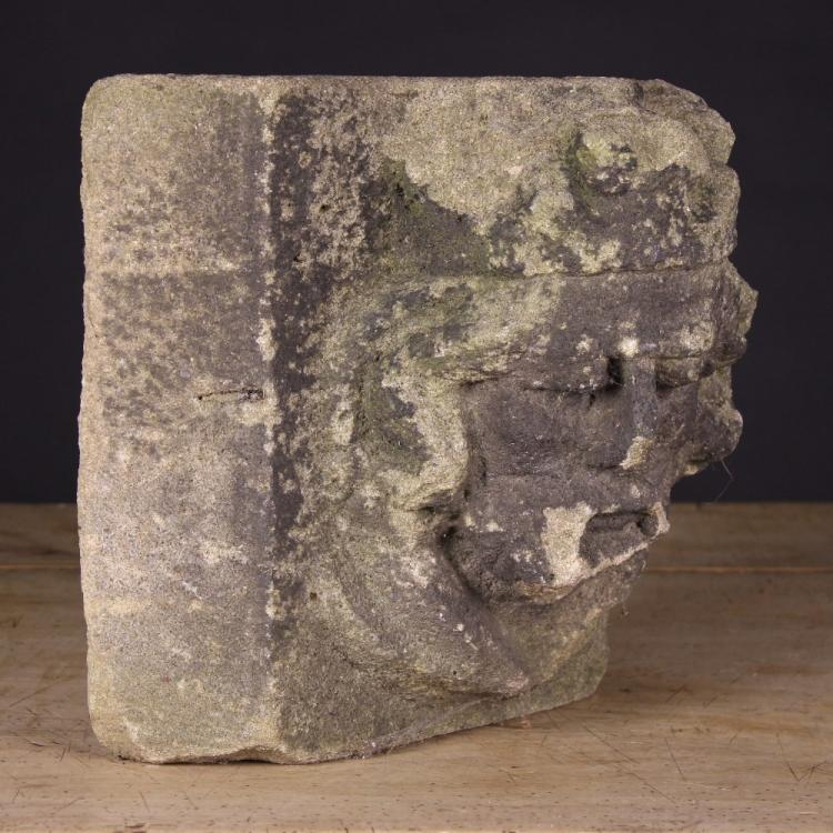 An architectural stone fragment carved with a gothic king s