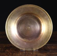 A Fine 16th Century Italian Spun Gilt Bronze Bowl with beaded rim, 10½ ins (27 cms) in diameter.