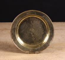 A 17th Century Bronze Lath-turned Dish, 10 ins (25.5 cms) in diameter.
