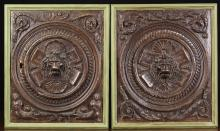 A Pair of 16th Century Carved Oak Renaissance Door Panels. The rectangular panels centred by lion masks in moulded roundels encircled by guilloche bands amidst scrolls of zoomorphic foliage. Now mounted in painted frames, 19 ins x 16 ins (48 cm x 41 cms).