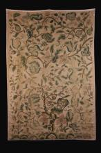 A 19th Century Crewel-work Panel embroidered in coloured wools on twill with a tree of life issuing foliage, scrolling tendrils, flowers and fruit with birds perched amongst the branches and small animals leaping over hilly mounts to the base, 82 ins x 56 ins (208 cm x 142 cms).