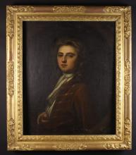 English School.  An 18th Century Oil on Canvas: Head & Shoulders Portrait of a Gentleman wearing a brown jacket with white cravat,  30 ins x 25 ins (76 cms x 64 cms). Set in a carved gilt frame 37 ins x 32 ins (94 cm x 82 cms).