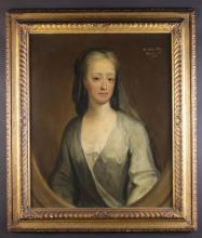 English School. Attrib. George Dowdney, (Active 1730-1750). An 18th Century Oil on Canvas: Head & Shoulders Portrait of a Lady inscribed 'Mrs Eliz. Pitt, March y 20th 1736' to the top right hand corner, 30 ins x 25 ins (76 cms x 64 cms). Contained in a gadrooned and granulated gilt frame with a small paper label to the back inscribed in pencil 'Father said these were by Dowdney in his Will', 37 ins x 31½ ins (94 cms x 80 cms).