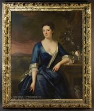 A Large 18th Century Oil on Canvas: Three-quarter Length Portrait of a Lady entitled bottom left; 'ANNE GODWIN by JNTN RICHARDSON 1723'. The 18th century moulded giltwood frame having a ribbon twist border within carved clusters of flowers & foliage, 58 ins x 49 ins (148 cms x 125 cms).
