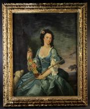 A Large Late 18th Century Oil on Canvas: Three-quarter Length portrait of a Lady holding a garland of flowers with a lamb at her side, 50 ins x 40 ins (127 cms x 102 cms). The 18th century giltwood frame carved with foliage, 60 ins x 49 ins (152 cms x 125 cms).