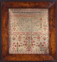 A Victorian Sampler worked by Susan Browning aged 15 years, and dated 1845, with alphabet above verse, birds, potted plants, baskets of fruit, crowns and small animal motifs in an undulating red currant border, 14 ins x 12½ins (35.5 cm x 31.5 cms), mounted in a birds-eye maple frame 18 ins x 16½ ins (46 cm x 42 cms).