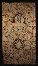 A 19th Century Woolwork Panel depicting The Start of Spring, with figures flanking a flowering tree surrounded by scrolls of flowers and foliage. Mounted on a stretcher 71 ins x 37 ins (180 cm x 94 cms).
