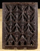 A 16th Century Oak Panel carved with elaborate Gothic tracery, 11 ins x 8¼ ins (28 cm x 21 cms).