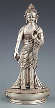 A FINELY CARVED SILVER PLATED BUDDHA